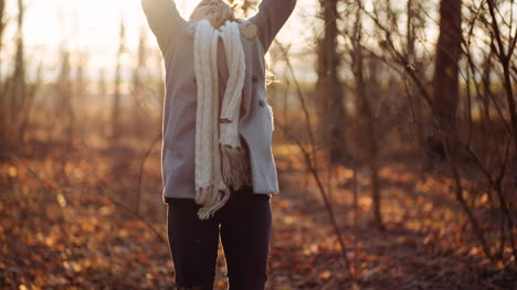 Positive-Happy-Woman-Throwing-Leaves-In-Autumn-In-Park-3