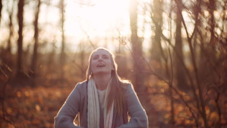 Positive-Happy-Woman-Throwing-Leaves-In-Autumn-In-Park-4