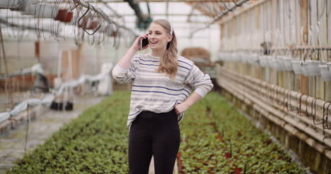 Agriculture-Female-Gardener-Using-Mobile-Phone-In-Greenhouse-4