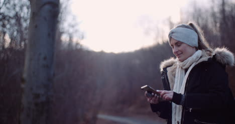 Technology-Woman-Using-Smartphone-To-Take-Picture-In-Autumn-2