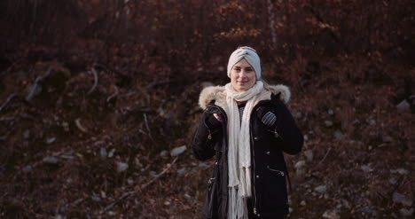 Positive-Female-Tourist-On-A-Trip-In-Mountains