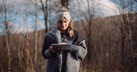 Female-Tourist-Taking-Brake-In-Mountains-And-Use-Digital-Tablet-1