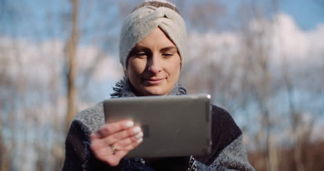 Female-Tourist-Taking-Brake-In-Mountains-And-Use-Digital-Tablet-2