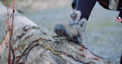Woman-Tying-Shoe-On-Tree-Trunk-1