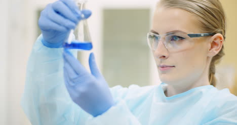 Female-Scientist-With-A-Pipette-Analyzes-A-Liquid-At-Laboratory