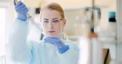 Female-Scientist-With-A-Pipette-Analyzes-A-Liquid-At-Laboratory-1