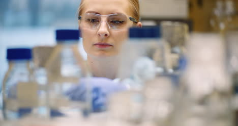 Scientist-Working-In-Laboratory-Microbiology-2