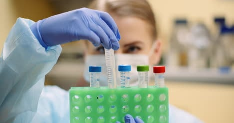 Scientist-Holding-Tubes-At-Laboratory-In-Molecular-Biotechnology-Laboratory