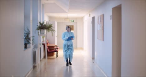 Scientist-Going-Corridor-At-Clinic