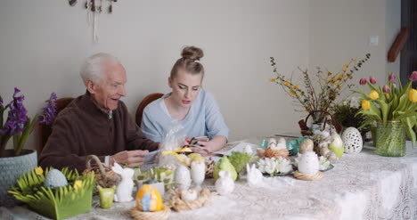 Woman-Spending-Time-With-Grandfather