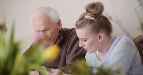 Happy-Easter-Grandfather-And-Granddaughter-Writing-Easter-Cards-With-Greetings-