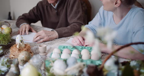 Happy-Easter-Grandfather-And-Granddaughter-Writing-Easter-Cards-With-Greetings-2
