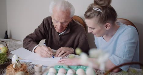 Grandfather-Writing-Letter-During-Easter-Holidays-1