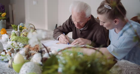 Grandfather-Writing-Letter-During-Easter-Holidays-2