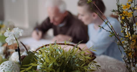 Grandfather-Writing-Letter-During-Easter-Holidays-3