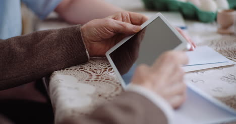 Granddaughter-With-Grandfather-Using-Digital-Tablet-2