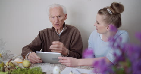 Granddaughter-With-Grandfather-Using-Digital-Tablet-4