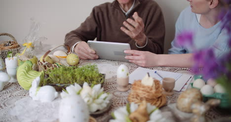 Granddaughter-With-Grandfather-Using-Digital-Tablet-5