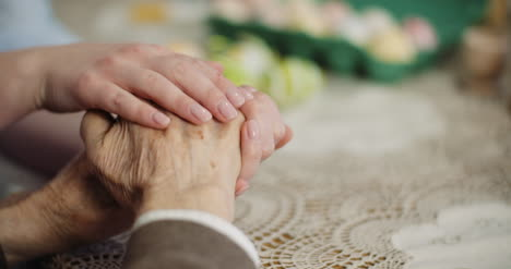Woman-Comforting-Wrinkled-Old-Hand-1