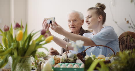 Senior-Man-And-Woman-Taking-Selfie-Photo-At-Easter-Holidays-1