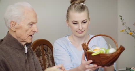 Woman-Giving-Easter-Basket-To-Grandfather-1