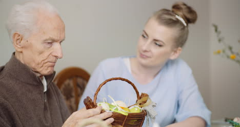 Woman-Giving-Easter-Basket-To-Grandfather-2
