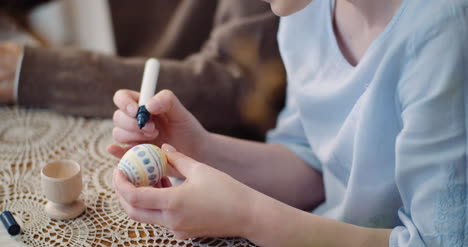 Hands-Coloring-Easter-Eggs-With-Colors-And-Brush-7