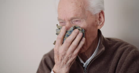 Senior-Man-Has-Cold-Snot-And-Sneezing