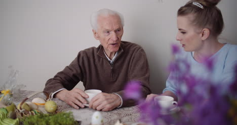 Woman-Spending-Time-With-Grandfather-2