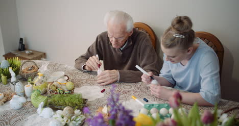 Senior-Man-And-Woman-Painting-Easter-Eggs