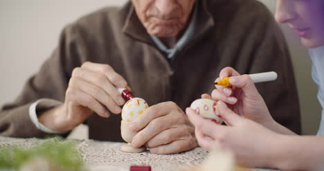 Senior-Man-And-Woman-Painting-Easter-Eggs-6