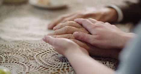 Woman-Comforting-Wrinkled-Old-Hand-3