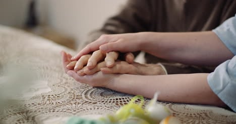 Woman-Comforting-Wrinkled-Old-Hand-4