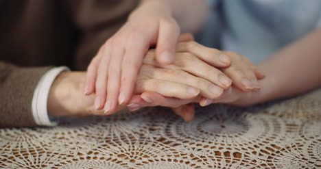 Woman-Comforting-Wrinkled-Old-Hand-5