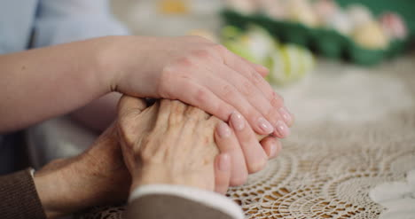 Woman-Comforting-Wrinkled-Old-Hand-6