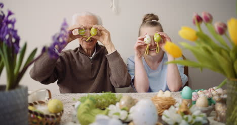 Happy-Easter-Cheerful-Grandfather-And-Granddaughter-Play-With-Easter-Eggs-On-Easter-1