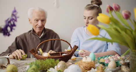 Happy-Easter-Grandfather-And-Granddaughter-Preparing-Easter-Decorations-1