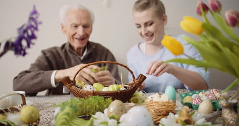 Happy-Easter-Grandfather-And-Granddaughter-Preparing-Easter-Decorations-2