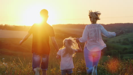 A-Friendly-Energetic-Family-Runs-To-Meet-The-Sun-Enjoys-Beautiful-Scenery