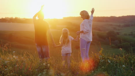 Young-Energetic-Mother-Jumping-With-Her-Niños-And-Enjoying-The-Last-Rays-Of-The-Setting-Sun