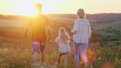 A-Friendly-Family-Has-Fun-Weekend-Walking-Through-The-Fields-At-Sunset