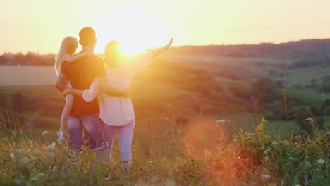 A-Friendly-Family-Spends-Time-In-Nature-Hugs-And-Enjoys-The-Sunset