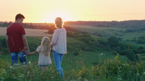 A-Little-Cool-Girl-Runs-To-Meet-The-Sunset-To-Her-Family-Back-View