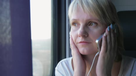 Young-Woman-Communicates-By-Phone-Goes-By-Train-Always-In-Touch-Business-Woman-Concept