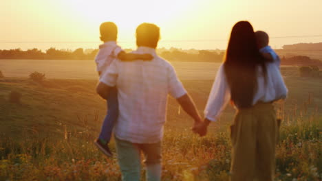 A-Young-Farming-Family-With-Children-Goes-To-Meet-The-Sun-Sunset