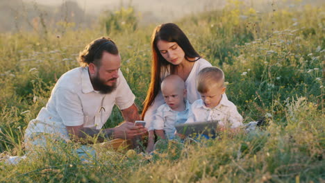 A-Stylish-Young-Woman-With-Long-Hair-Along-With-A-Bearded-Husband-And-Two-Small-Cool-Children-Watchi