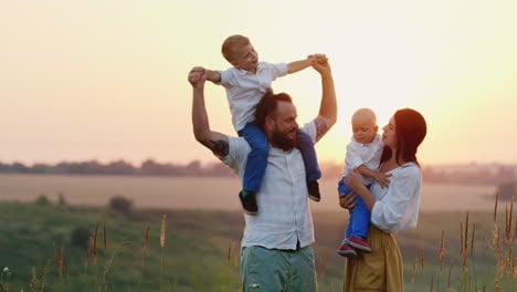 Happy-Children-And-Their-Parents-Are-Happy-Together-With-The-Sun-Living-Nature-And-Fresh-Air-Sunset