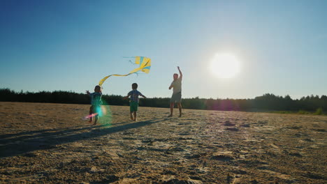 Young-Father-Playing-With-His-Two-Sons-Flying-A-Kite