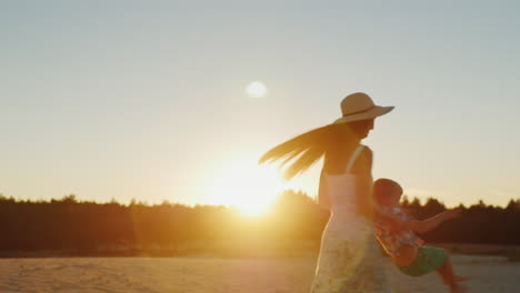 Young-Mother-With-Long-Hair-Playing-With-His-Son-At-Sunset-Fun-Turns-It-Around
