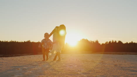 The-Little-Boy-Takes-The-First-Steps-In-The-Sunset-My-Mother-Supports-Him